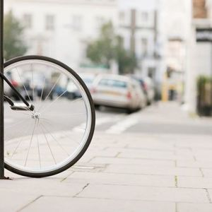 Small single bicycle wheel secured to lamp post royalty free image 139266765 1549924365