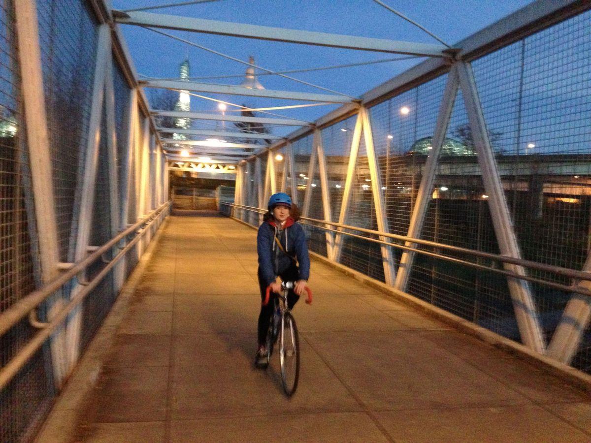 Erin bikes Portland bridge